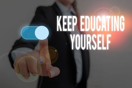 Word writing text Keep Educating Yourself. Business photo showcasing dont stop studying Improve yourself using Courses Woman wear formal work suit presenting presentation using smart device Stock Photo