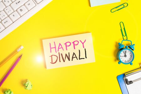 Handwriting text Happy Diwali. Conceptual photo festival of lights that celebrated by millions of Hindus Flat lay above copy space on the white crumpled paper