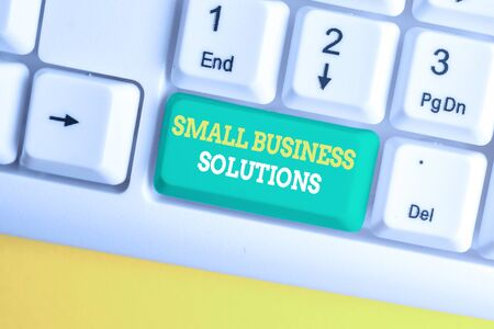 Writing note showing Small Business Solutions. Business concept for a Company to solve Specific Trade problems White pc keyboard with note paper above the white background Stok Fotoğraf