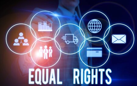 Writing note showing Equal Rights. Business concept for Equality before the law when all showing have the same rights Woman wear formal work suit presenting presentation using smart device Stok Fotoğraf