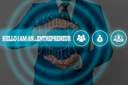 Handwriting text writing Hello I Am An Entrepreneur. Conceptual photo demonstrating who sets up a business or startups Male human wear formal work suit presenting presentation using smart device Фото со стока