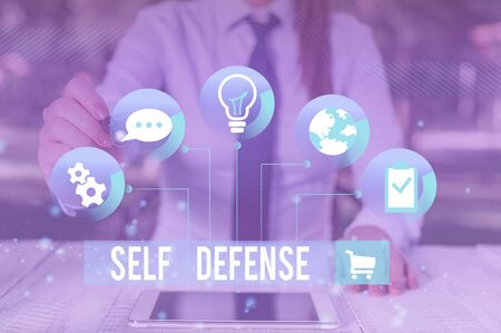 Writing note showing Self Defense. Business concept for the act of defending one s is demonstrating when physically attacked Female human wear formal work suit presenting smart device