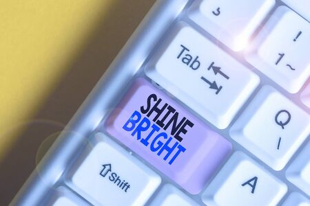 Handwriting text writing Shine Bright. Conceptual photo make an effort to live normally when in a difficult situation White pc keyboard with empty note paper above white background key copy space