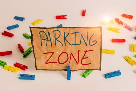 Word writing text Parking Zone. Business photo showcasing a space where an automobile can be parked Allowed to parked Colored clothespin papers empty reminder white floor background office