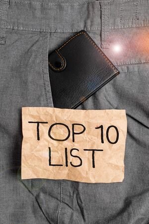 Word writing text Top 10 List. Business photo showcasing the ten most important or successful items in a particular list Small little wallet inside man trousers front pocket near notation paper