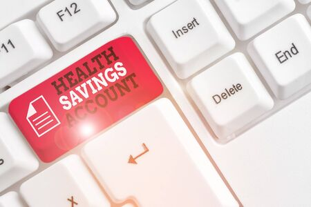 Word writing text Health Savings Account. Business photo showcasing users with High Deductible Health Insurance Policy White pc keyboard with empty note paper above white background key copy space