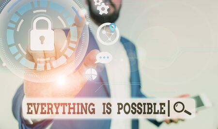 Text sign showing Everything Is Possible. Business photo text Any outcome could occur Anything can happen Male human wear formal work suit presenting presentation using smart device Foto de archivo