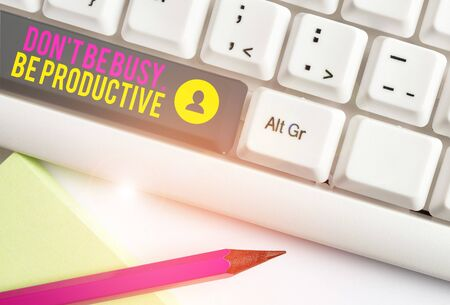 Text sign showing Don T Be Busy Be Productive. Business photo text Work efficiently Organize your schedule time White pc keyboard with empty note paper above white background key copy space