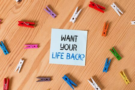 Writing note showing Want Your Life Back Question. Business concept for Have again our Lives Take Control of our Being Colored clothespin papers empty reminder wooden floor background office 写真素材