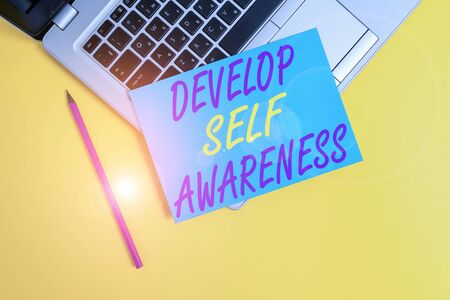 Conceptual hand writing showing Develop Self Awareness. Concept meaning increase conscious knowledge of own character Metallic laptop small paper sheet pencil colored background