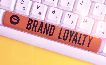Word writing text Brand Loyalty. Business photo showcasing Repeat Purchase Ambassador Patronage Favorite Trusted White pc keyboard with empty note paper above white background key copy space Imagens
