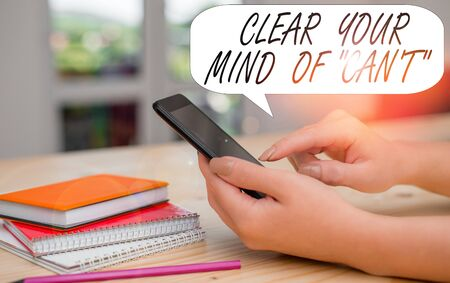 Conceptual hand writing showing Clear Your Mind Of Can T. Concept meaning Have a positive attitude thinking motivation woman using smartphone and technological devices inside the home