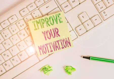 Writing note showing Improve Your Motivation. Business concept for Boost your self drive Enhance Motives and Goals Green note paper with pencil on white background and pc keyboard