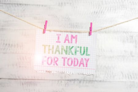 Writing note showing I Am Thankful For Today. Business concept for Grateful about living one more day Philosophy Clothesline clothespin rectangle shaped paper reminder white wood desk