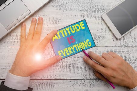Writing note showing Attitude Is Everything. Business concept for Positive Outlook is the Guide to a Good Life