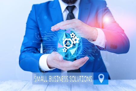 Conceptual hand writing showing Small Business Solutions. Concept meaning a Company to solve Specific Trade problems Male human wear formal suit presenting using smart device
