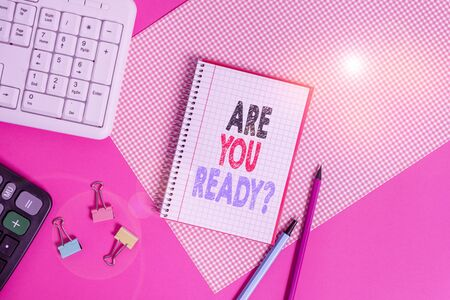 Text sign showing Are You Ready Question. Business photo showcasing Setting oneself on the activity Being Prepared Writing equipments and computer stuffs placed above colored plain table