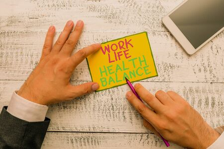 Writing note showing Work Life Health Balance. Business concept for Stability and Harmony to prevent burnt out Stock Photo