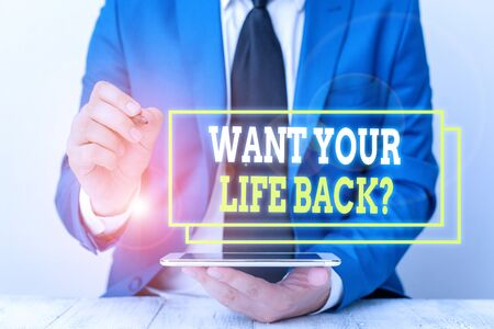 Conceptual hand writing showing Want Your Life Back Question. Concept meaning Have again our Lives Take Control of our Being Businessman pointing with pen in empty copy space
