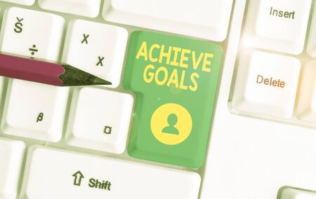 Writing note showing Achieve Goals. Business concept for Results oriented Reach Target Effective Planning Succeed White pc keyboard with note paper above the white background