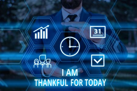 Word writing text I Am Thankful For Today. Business photo showcasing Grateful about living one more day Philosophy Male human wear formal work suit presenting presentation using smart device