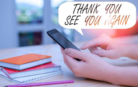 Conceptual hand writing showing Thank You See You Again. Concept meaning Appreciation Gratitude Thanks I will be back soon woman using smartphone and technological devices inside the home