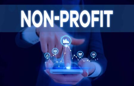 Conceptual hand writing showing Non Profit. Concept meaning type of organization that does not earn profits for its owners Woman wear work suit presenting presentation smart device