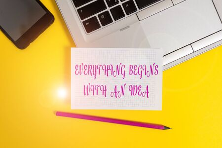 Text sign showing Everything Begins With An Idea. Business photo text steps you take to turn an idea into a reality Metallic laptop pencil squared paper sheet smartphone colored background