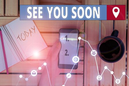 Writing note showing See You Soon. Business concept for used for saying goodbye to someone and going to meet again soon Stok Fotoğraf