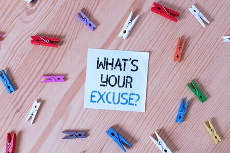 Writing note showing What S Your Excuse Question. Business concept for Explanations for not doing something Inquiry Colored clothespin papers empty reminder wooden floor background office