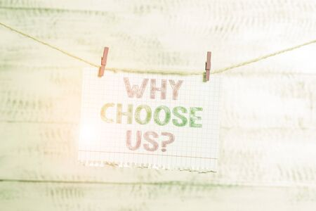 Writing note showing Why Choose Us Question. Business concept for Reasons for choosing our brand over others arguments Clothesline clothespin rectangle shaped paper reminder white wood desk 写真素材