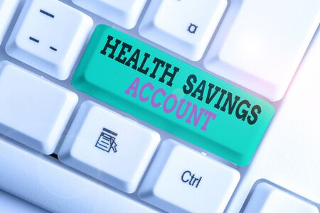 Handwriting text writing Health Savings Account. Conceptual photo users with High Deductible Health Insurance Policy White pc keyboard with empty note paper above white background key copy space Stock Photo