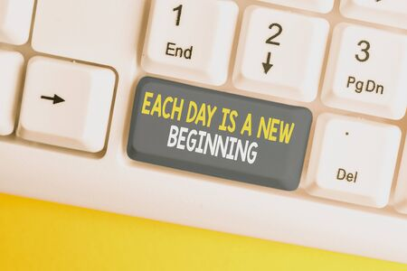 Conceptual hand writing showing Each Day Is A New Beginning. Concept meaning Every morning you can start again Inspiration White pc keyboard with note paper above the white background Stok Fotoğraf