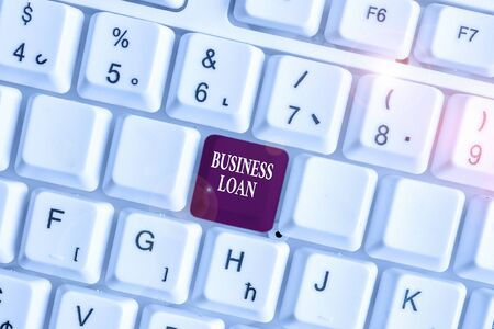 Text sign showing Business Loan. Business photo text Credit Mortgage Financial Assistance Cash Advances Debt White pc keyboard with empty note paper above white background key copy space Banco de Imagens - 131348599