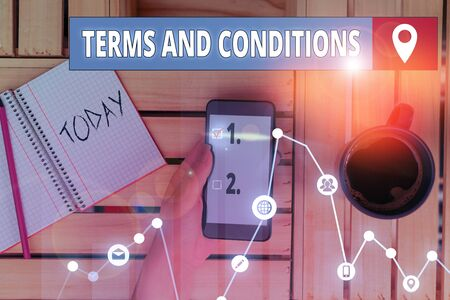 Writing note showing Terms And Conditions. Business concept for rules that apply to fulfilling a particular contract