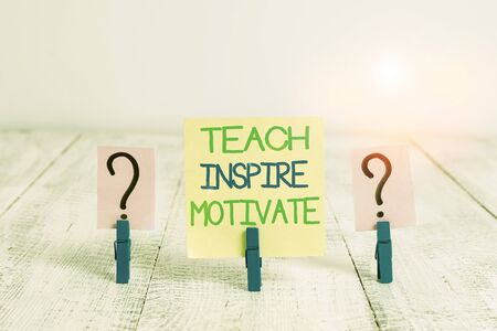 Conceptual hand writing showing Teach Inspire Motivate. Concept meaning Spark the Imagination to Feel the need to Learn Crumbling sheet with paper clips placed on the wooden table Stok Fotoğraf
