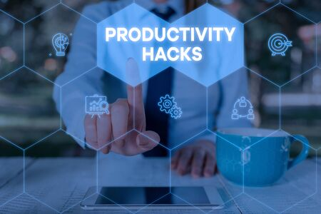 Word writing text Productivity Hacks. Business photo showcasing tricks that you get more done in the same amount of time Woman wear formal work suit presenting presentation using smart device Stok Fotoğraf
