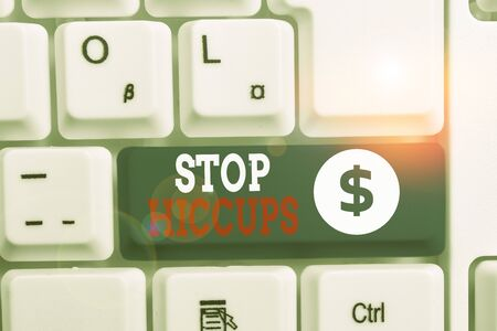 Writing note showing Stop Hiccups. Business concept for get rid of the involuntary spasm of the diaphragm muscles White pc keyboard with note paper above the white background