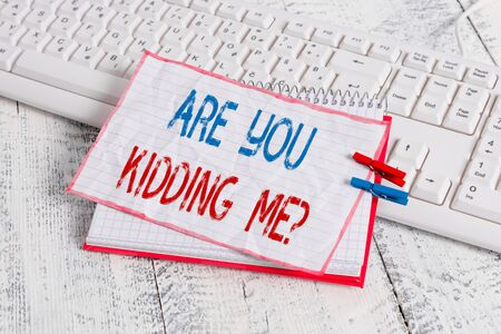 Word writing text Are You Kidding Me Question. Business photo showcasing Expression of Disbelief or could not be true notebook paper reminder clothespin pinned sheet white keyboard light wooden Stock Photo