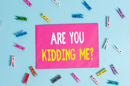 Conceptual hand writing showing Are You Kidding Me Question. Concept meaning Expression of Disbelief or could not be true Colored clothespin rectangle shaped paper blue background
