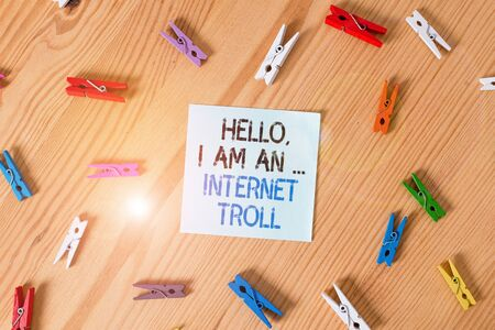 Writing note showing Hello I Am An Internet Troll. Business concept for Social media troubles discussions arguments Colored clothespin papers empty reminder wooden floor background office