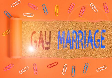 Writing note showing Gay Marriage. Business concept for entered into in a civil or religious ceremony of the same sex Archivio Fotografico