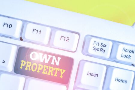 Word writing text Own Property. Business photo showcasing Things that you own and can take it with you Movable Tangible White pc keyboard with empty note paper above white background key copy space