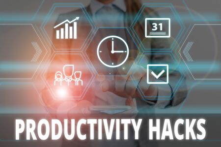 Writing note showing Productivity Hacks. Business concept for tricks that you get more done in the same amount of time Woman wear formal work suit presenting presentation using smart device Stok Fotoğraf