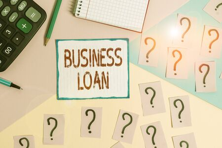 Writing note showing Business Loan. Business concept for Credit Mortgage Financial Assistance Cash Advances Debt Mathematics stuff and writing equipment above pastel colours background Banco de Imagens - 131273488