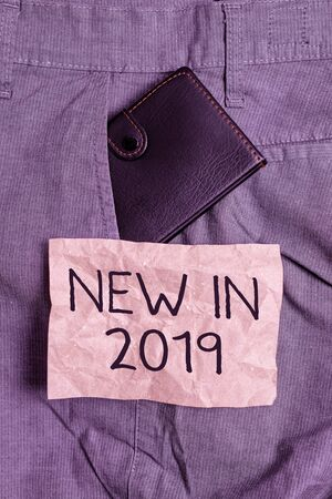 Word writing text New In 2019. Business photo showcasing what will be expecting or new creation for the year 2019 Small little wallet inside man trousers front pocket near notation paper