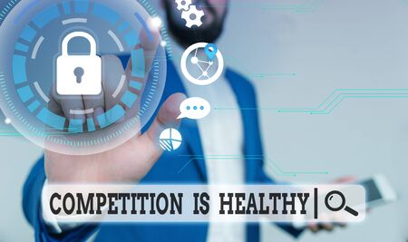 Text sign showing Competition Is Healthy. Business photo text Rivalry is good in any Venture leads to Improvement Male human wear formal work suit presenting presentation using smart device