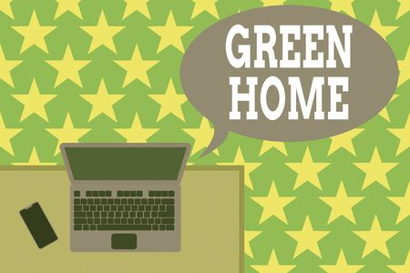 Handwriting text Green Home. Conceptual photo An area filled with plants and trees where you can relax Upper view office working place laptop lying wooden desk smartphone side Stok Fotoğraf