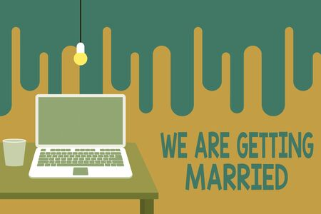 Word writing text We Are Getting Married. Business photo showcasing Engagement Wedding preparation Loving couple Front view open laptop lying on wooden desktop light bulb falling glass