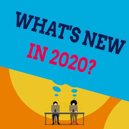 Text sign showing What S New In 2020 Question. Business photo text Expectation and Surprises for the coming Year Two men sitting behind desk each one laptop sharing blank thought bubble Stok Fotoğraf